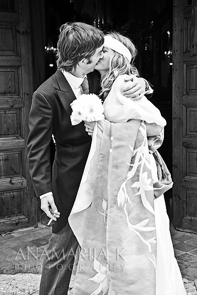 a passionate kiss in front of the church