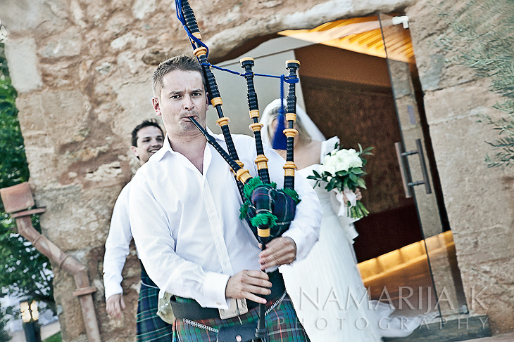 the sound of bagpipes accompanying the newly married couple