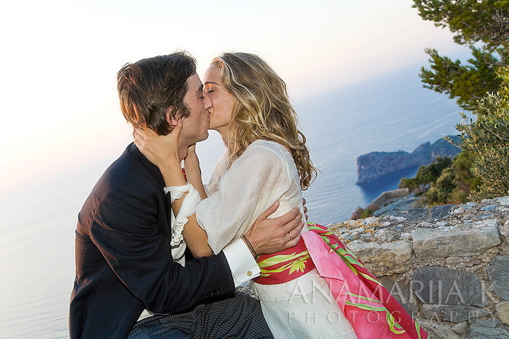 a passionate kiss with an impressive view